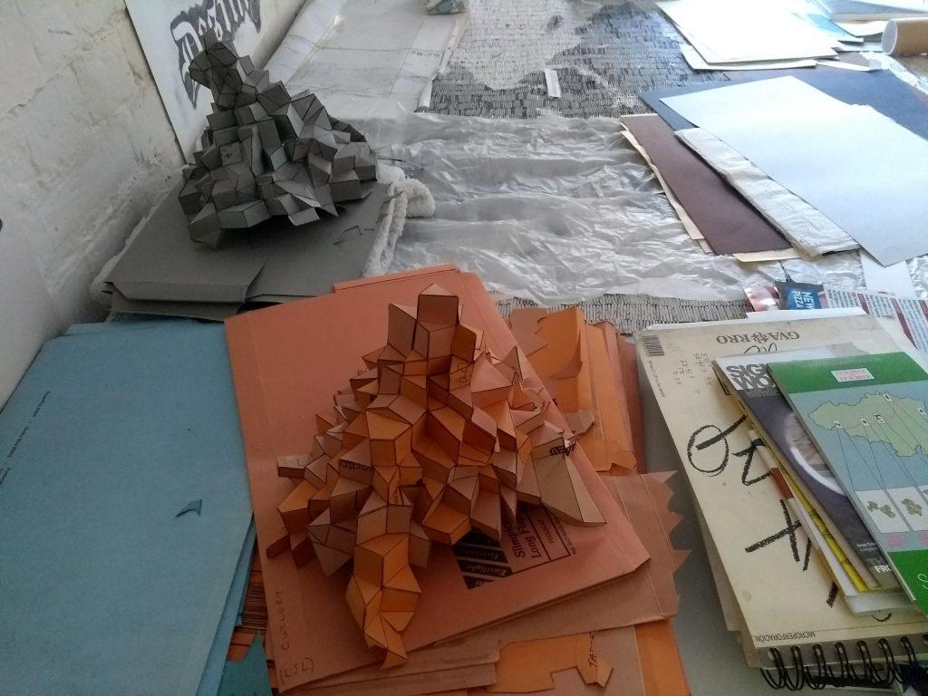 Ci/SfB geometric sculptures in orange and grey card