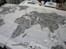 'Letters from the bank' a map of the world made from letters from the bank, cut rolled and glued into bead forms, then woven together using a beading technique.